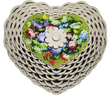 A heart shaped wooden candy bowl.  KREMLINA chocolate prune 400g